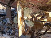image of festering  - old rusty propeller ona rotten wooden boat - JPG