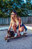 Woman On Skate, Cat Pet Pussy, Summer In City, Background Fence Road. Denim Baseball Cap Long Hair.  poster