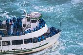 Beautiful View Of Excursion Boat Full With Tourists In Blue Clothes. Tourist Concept. Transportation poster
