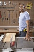 Portrait of man with table saw
