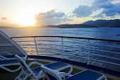 stock photo of cruise ship caribbean  - The sun sets over the caribbean island of St - JPG