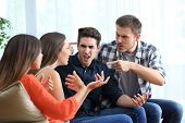 Four Angry Friends Arguing Accusing Each Others At Home poster