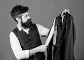 At Mens Shop. Shop Assistant Offering Wide Choice Of Business Casual Wear. Bearded Man Matching Luxu poster
