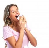 Sneezing woman having cold. On a white background.