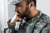 Pensive Bearded Military Man In Uniform Holding Hand Near Face poster