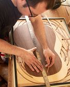 Marking And Gluing Of Footer To The Back Deck Of Classical Guitar. Production Of Classical Guitar. poster