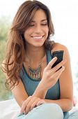 image of daydreaming  - Happy Woman Looking and Text Messaging On The Smart Phone - JPG