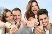 Group Of Happy Smiling Friends Showing Thumb Up Sign