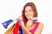 Beautiful Young Girl With Shopping Bags And Discount Card