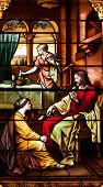 Stained glass window of Jesus, Martha and Mary