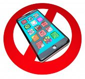 A red No or Stop sign over a smart phone showing apps to warn you not to use your telephone in a cer