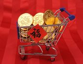 Gold coins in shopping cart,Chinese New Year Calligraphy for