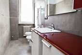 stock photo of lavabo  - Red bathroom with toilette bidet heater lavabo and mirror - JPG