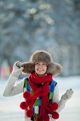 Young woman in a snowy furry hood poster