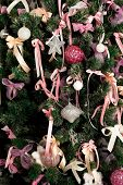 A Part Of Fir tree With Ornaments And Decorations