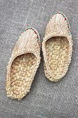 Wicker Rounders Against Coarse Linen Fabric