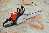 Chainsaw Is On Background Wooden Shavings
