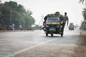 Overloaded And Tuk-tuks Motorcycles On Covered By Haze Route, Central India