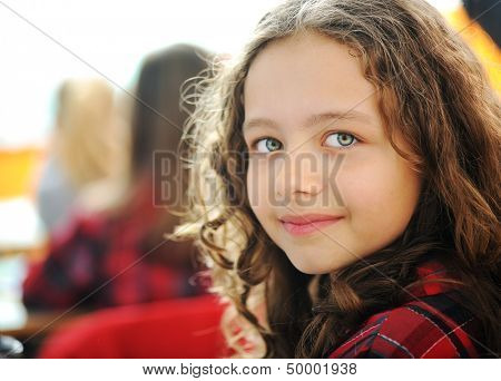 Cute lovely school children at classroom having education activities poster