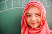 stock photo of hijabs  - Cute lovely Arabic school children at classroom having education activities - JPG