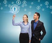business, technology, internet and networking concept - man and woman working with virtual screen