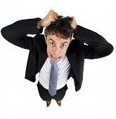 High angle fun portrait of a mature business man tearing out his hair in desperation and frustration isolated on white
