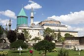 pic of sufi  - Tomb of Mevlana the founder of Mevlevi sufi dervish order with prominent green tower in Konya Turkey - JPG