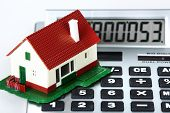House and calculator. Real estate concept background.