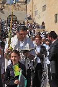 Jerusalem - October 16Sacred Western wall of the Temple. Jewish family - the father in religious clo