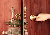 Hand opens door close-up
