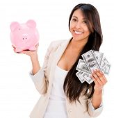 Woman saving money in a piggybank - isolated over white background