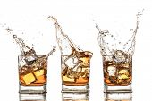 foto of neat  - Isolated shots of whiskey with splash on white background - JPG