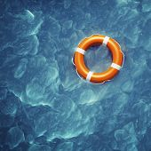 stock photo of sos  - Lifebuoy in a stormy blue sea - JPG