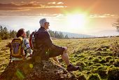 stock photo of silence  - seniors hiking in nature on an autumn day - JPG