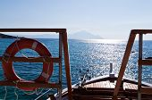 Ship at aegean sea  and a holy mountain Athos in background