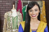image of dupatta  - Portrait of a beautiful Indian female dressmaker smiling - JPG