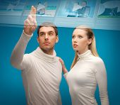 future technology, internet and networking concept - man and woman working with virtual screen