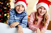 Portrait of charming brother and sister enjoying Christmastime