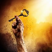 pic of struggle  - Key in human hand - JPG
