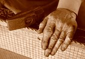 image of blacksmith shop  - Hands of an old blacksmith in tinted black and white - JPG