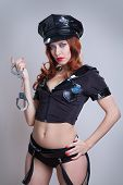 beauty sexy police woman on gray background