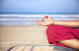 picture of pranayama  - Meditation mudra of man in red trousers on the beach at ocean background - JPG