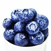 Fresh Bilberries In A Bowl  Isolated On White Background Macro.