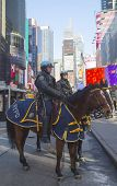 NYPD police officers on horseback ready to protect public on Times Square during Super Bowl XLVIII