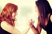 Two womans hands fight
