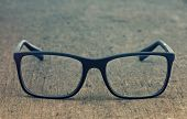 foto of geek  - Geek eyeglasses laying on a grungy wooden background with retro filter effect - JPG