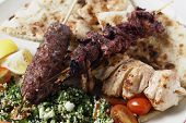 image of tabouleh  - Various barbecued kebabs  - JPG