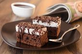 image of sponge-cake  - Chocolate cakes with meringue frosting and chocolate sauce on a plate - JPG