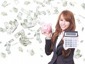 Woman Smiling With Piggy Bank And Calculator