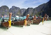 Traditional longtail boats in the famous Maya bay of Phi-phi Leh island, Thailand